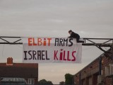 Protester-hangs--Elbit-Arms--Israel-Kills--at-shutdown-Elbit-factory-in-Birmingham--The-factory-produces-drone-engines-which-are-exported-to-Israel-and-used-over-Gaza