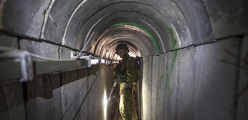 An Israeli army officer walks on July 25, 2014 during an army-organised tour in a tunnel said to be used by Palestinian militants from the Gaza Strip for cross-border attacks. Israel launched its military offensive aiming at destroying tunnels used by Gaza militants. AFP PHOTO / POOL / JACK GUEZ (Photo credit should read JACK GUEZ/AFP/Getty Images)